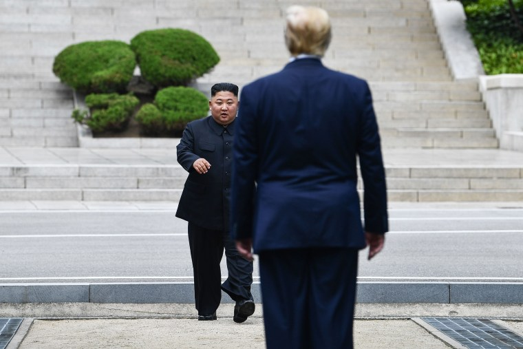 North Korea's leader Kim Jong Un walks to greet Donald Trump at the Military Demarcation Line that divides North and South Korea, in the Joint Security Area (JSA) of Panmunjom in the Demilitarized zone (DMZ) on June 30, 2019.