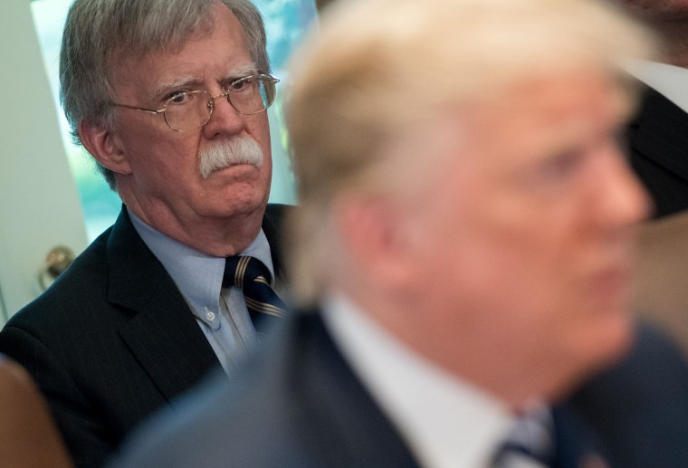 In this file photo taken on May 9, 2018, US President Donald Trump speaks alongside National Security Adviser John Bolton during a Cabinet Meeting in the Cabinet Room of the White House in Washington, D.C.