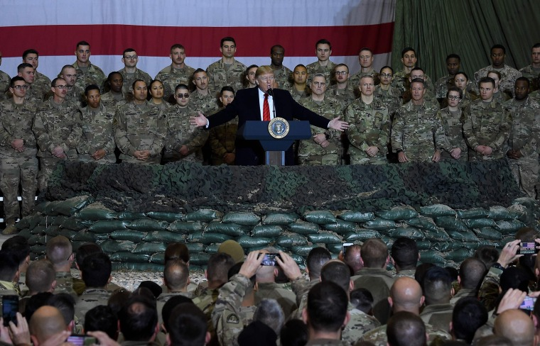 In this file photo taken on November 28, 2019 US President Donald Trump speaks to the troops during a surprise Thanksgiving day visit at Bagram Air Field, in Afghanistan.