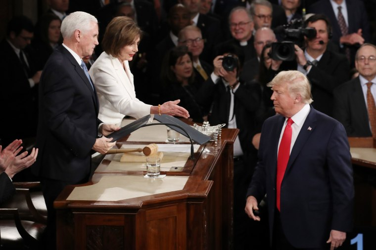 House Speaker Rep. Nancy Pelosi attempts to shake hands with President Donald Trump in the beginning of the State of the Union address as Vice President Mike Pence looks on in the chamber of the U.S. House of Representatives on February 04, 2020 in Washin