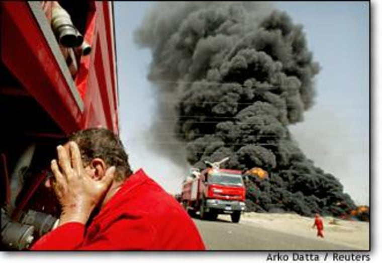 A fireman washes his face for relief from the heat of a raging fire at a crude oil pipeline near Bayji, Iraq last Thursday. Post-war looting has delayed Iraq's attempts to get crude capacity back up to pre-war levels.