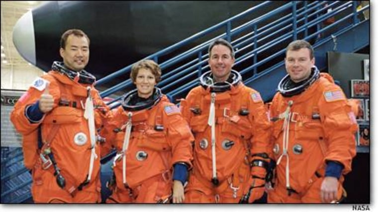 The core group for the next shuttle mission renames unchanged: from left, Soichi Noguchi, commander Eileen Collins, Steve Robinson and Jim Kelly. But the three other slots have been emptied to to make room for those with specialized skills needed for the flight's new responsibilities.