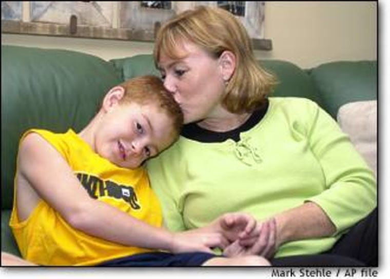 Cindy Clark, a sales leader at Ikea, is seen with her 7 year-old son Ryan at their home in East Norriton, Pa., this September. Clark was allowed to take 6 months off from work to care for Ryan, who has Leukemia.