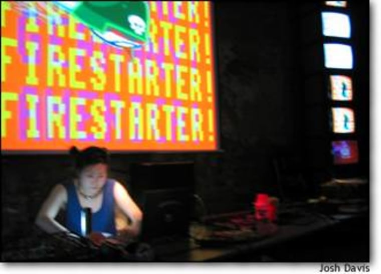 Haeyoung Kim, aka Bubblyfish, makes music courtesy of a Gameboy and a laptop at an 8-bit music festival in New York City.