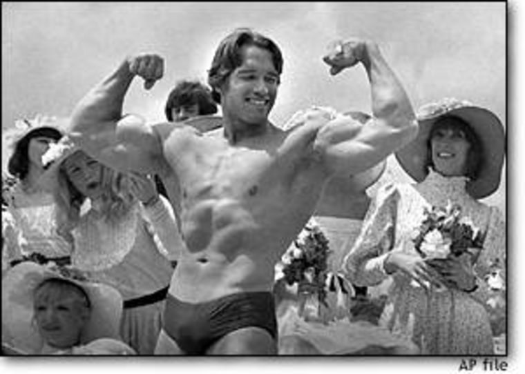 Arnold Schwarzenegger shows off his body for an appreciative audience on May 20, 1977, in Cannes, France, where his documentary film 'Pumping Iron' was being presented at the Cannes Film Festival.