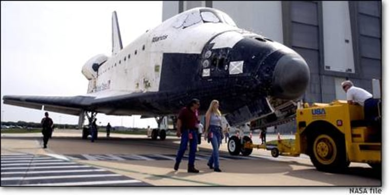 In a NASA photo from March, the shuttle Atlantis is towed away from the Vehicle Assembly Building at Kennedy Space Center in Florida. Atlantis is currently being processed for flight. NASA says concerns about inadequate inspection of the shuttle's nose cap, visible at the very tip of the spacecraft, could prompt additional delays in the launch schedule.