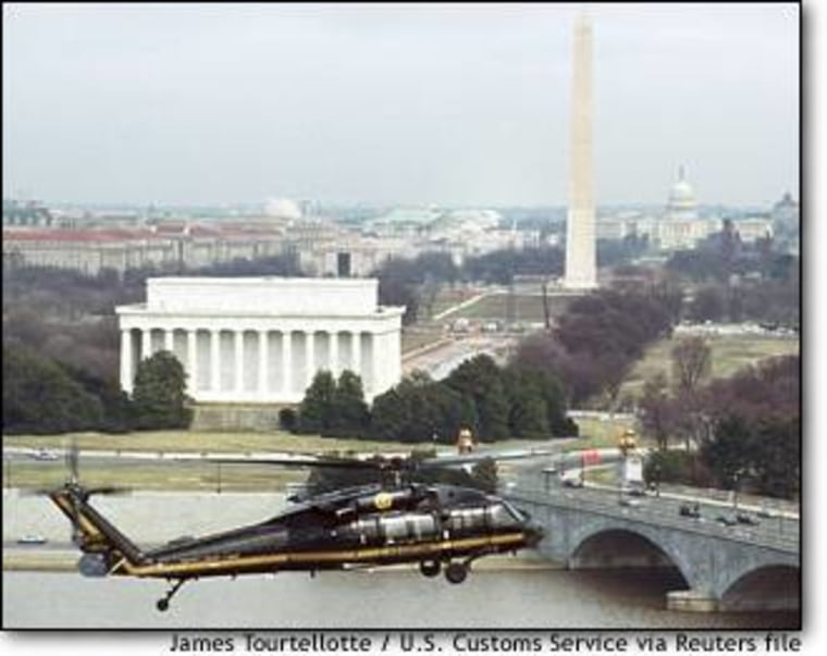 An Immigration and Customs Enforcement Blackhawk helicopter flies over Washington in March.