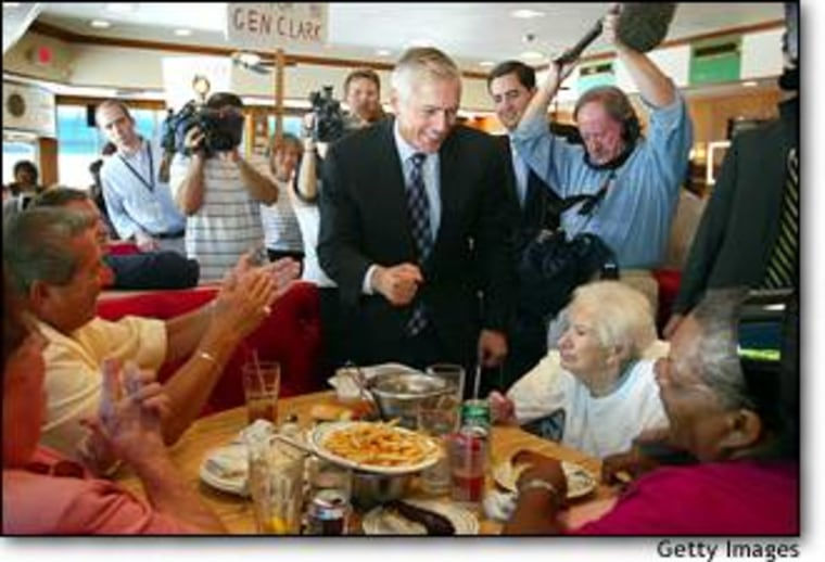 Democratic presidential hopeful Wesley Clark, center, talks to diners at the Rascal House restaurant Monday in Sunny Isles, Fla., where more than 150 supporters greeted the retired general.