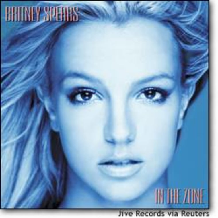 "Singer Britney Spears is pictured on the cover of her first album in two years, titled ""In The Zone."" The first single from the album, titled ""Me Against the Music,"" is being boosted by a steamy music video featuring Spears and singer Madonna."
