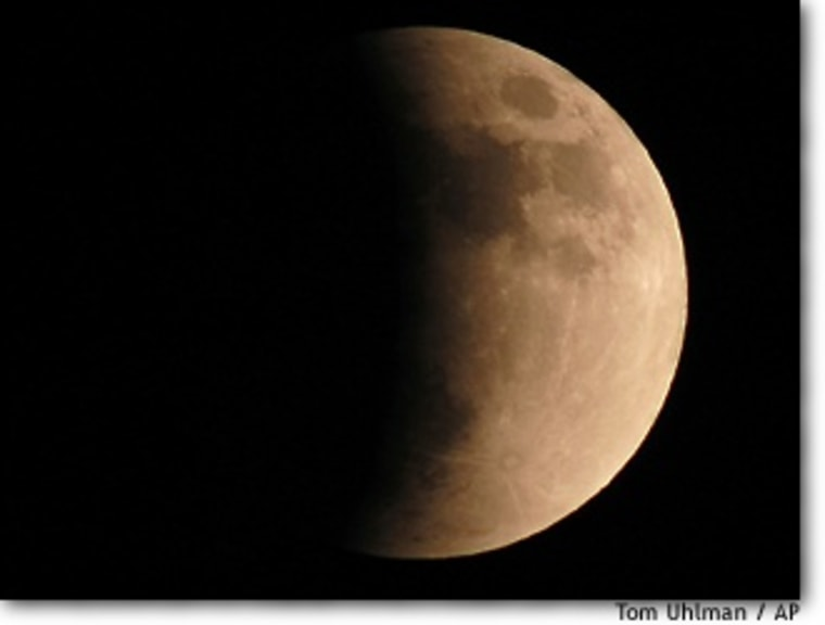 Saturday night's lunar eclipse turns the moon red, as seen from the Cincinnati Observatory. Hundreds lined up to peer through the observatory's telescope and others that were brought by amateurs.