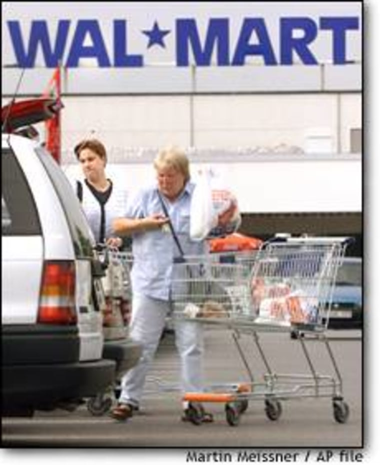 Customers load a vehicle in front of a Wal-Mart Supercenter in Dortmund, Germany, the retailer's first store to open in the country four years ago. While Wal-Mart has seen success in the U.K., its German locations have lagged.