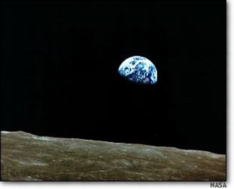 """The rising Earth looms above the lunar horizon in this telephoto view taken from the Apollo 8 spacecraft. For years, space historians have debated who took this picture. The book """"Genesis"""" provides the answer."""