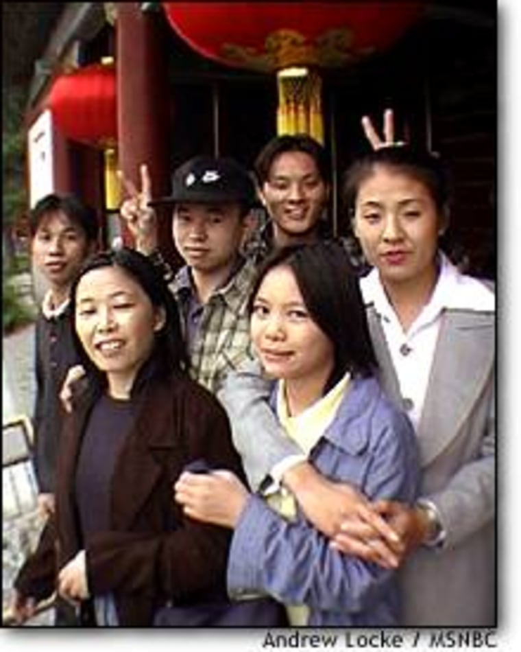 A group of friends from Guangdong province pose during a visit to the Summer Palace in Beijing.
