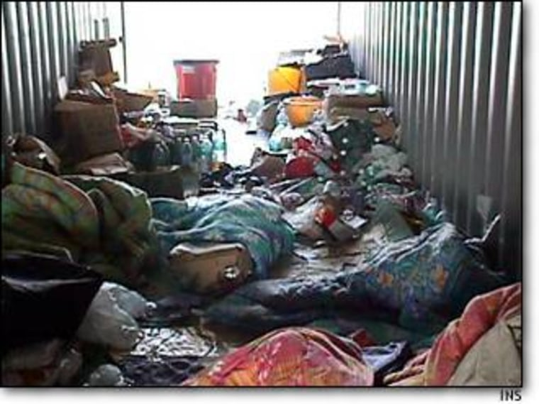 Litter and bedding covers the floor of the hard-top container used to smuggle 15 Chinese nationals to the United States.