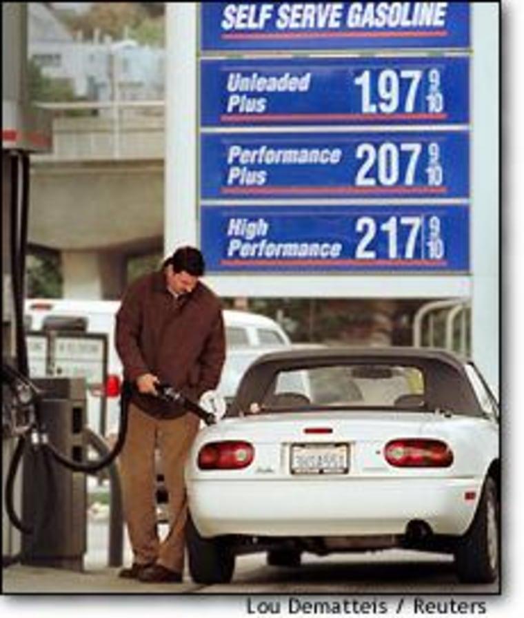 A motorist fills his tank at a San Francisco service station Tuesday.