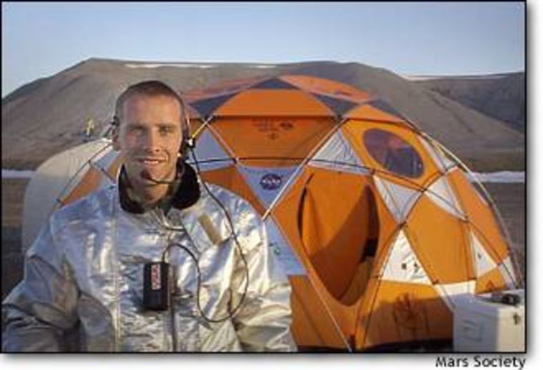 """Scottish geologist Gordon """"Oz"""" Ozinski wears a prototype spacesuit at the Haughton-Mars Project, on Devon Island in the Canadian Arctic. The crater site is considered one of the most Marslike places on Earth. Click to find out more about the Haughton-Mars Project."""
