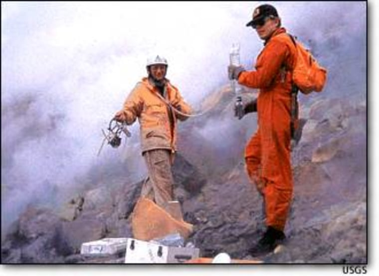 Geologists collect gas samples around Mount St. Helens' dome in 1981. Samples are gathered from vents on the dome and crater floor, and are used to monitor changes in the volcano. Sulfur dioxide emissions, for example, rise dramatically during an eruption.