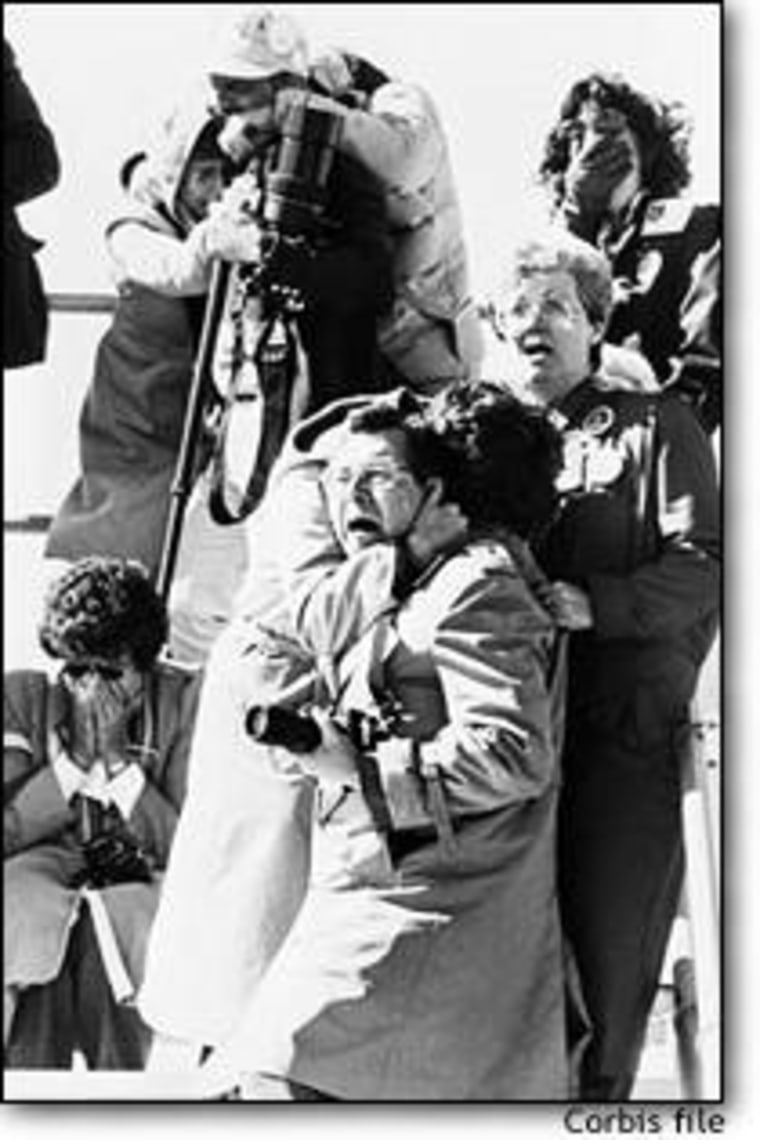 From Jan. 28, 1986: Faces of spectators register horror, shock and sadness after witnessing the explosion of the space shuttle Challenger 73 seconds after liftoff. It would take more than 10 weeks to find the remains of the astronauts who died.