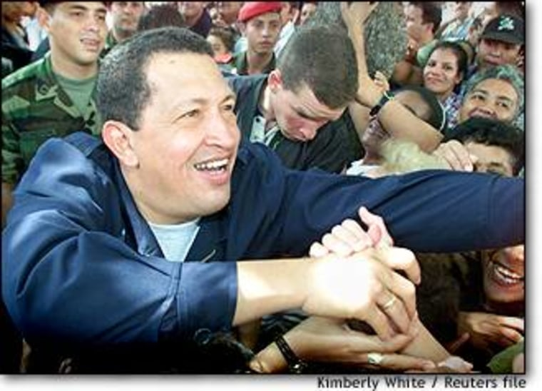 Venezuelan President Hugo Chavez greets supporters during a referendum campaign that gave him sweeping powers in December 2000.