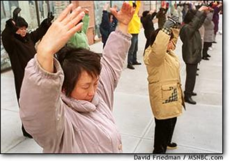Nancy Lin and around 60 of her fellow Falun Gong practitioners go through their exercises outside the Chinese consulate in New York last week.