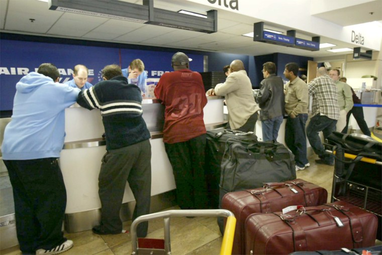 Passengers check in at an Air France ticket counter at Los Angeles International Airport in December.
