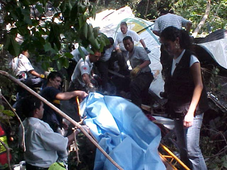 Medics and rescue team members recover the bodies of victims of a bus accident in Nayarit, Mexico, on Saturday.