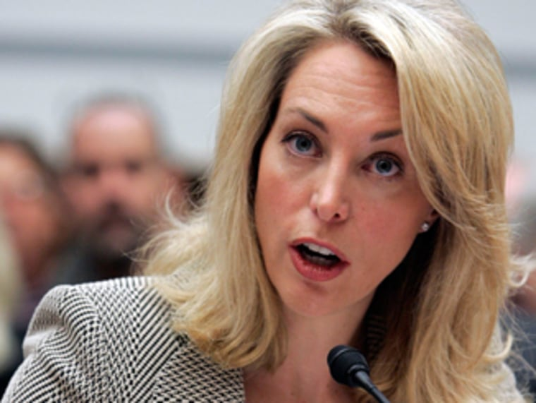 Former CIA employee Valerie Plame Wilson testifies at a House Oversight and Government Reform Committee hearing on Capitol Hill in Washington