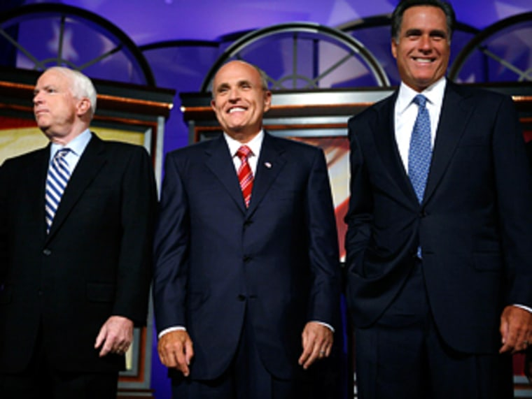 Republican presidential candidates McCain, Giuliani and Romney stand before debate at Drake University in Des Moines