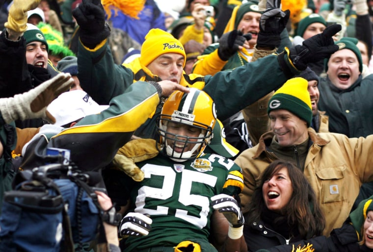 Image: Packers running back Ryan Grant celebrates with fans after a touchdown against the Detroit Lions