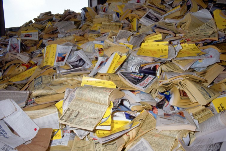 Image: Pile of yellow pages.