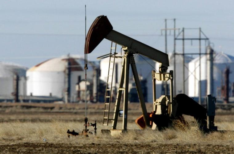 Image: oil pump near refinery