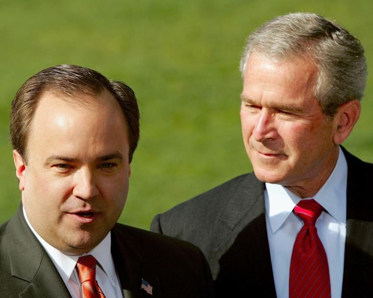 Image: U.S. President George W. Bush listens as his Press Secretary, Scott McClellan, announces his resignation.