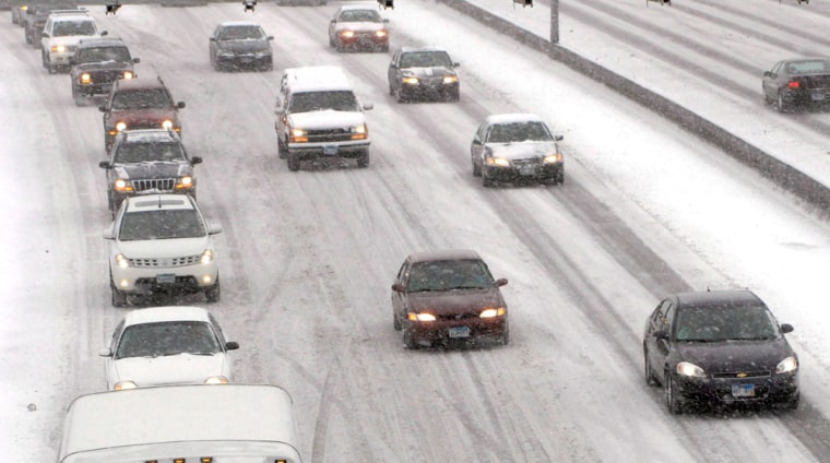 Image: Traffic on Interstate 94 was slow going as a major snow storm hits in Minneapolis, Minnesota