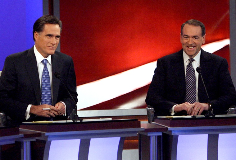 Image: Republican presidential candidates Mitt Romney (L) and Mike Huckabee during the GOP debates.