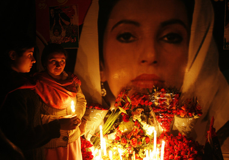 Image: Supporters of Benazir Bhutto hold candles during a homage ceremony.
