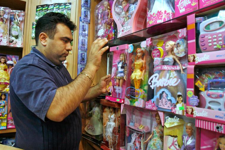 Image: Iranian shopkeeper Hamid Reza Delband