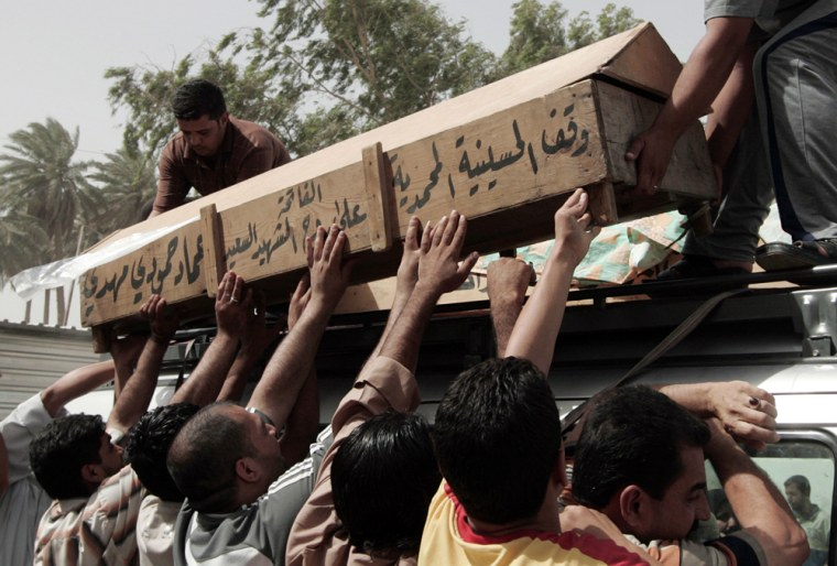Image: Mourners carry coffin of resident killed in bomb attack in Baghdad