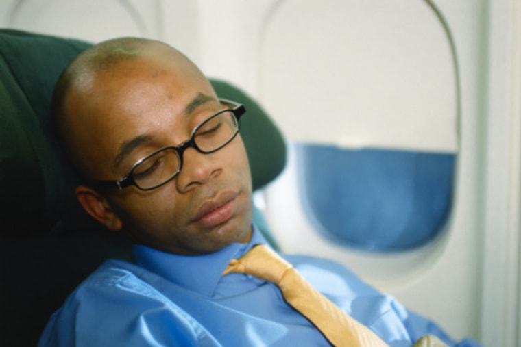 Image: Businessman sleeping in airplane