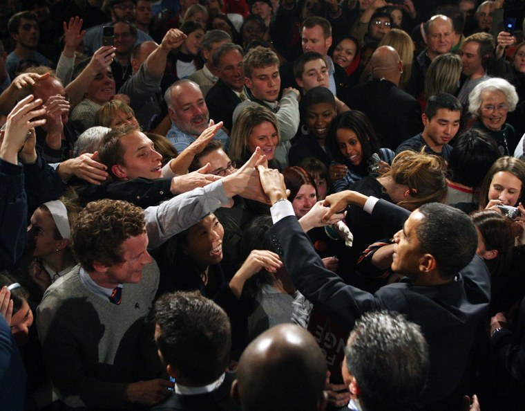 Image: Senator Barack Obama greets supporters gathered for a post-caucus celebration in Des Moines, Iowa.