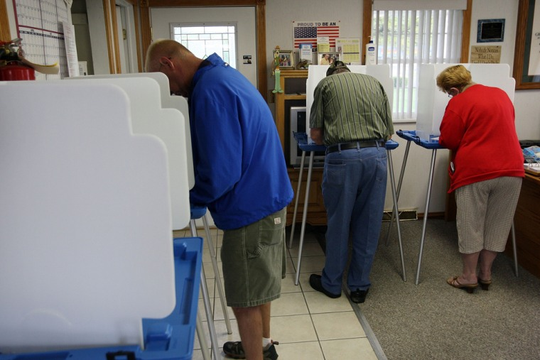 Image:  Voters mark their ballots