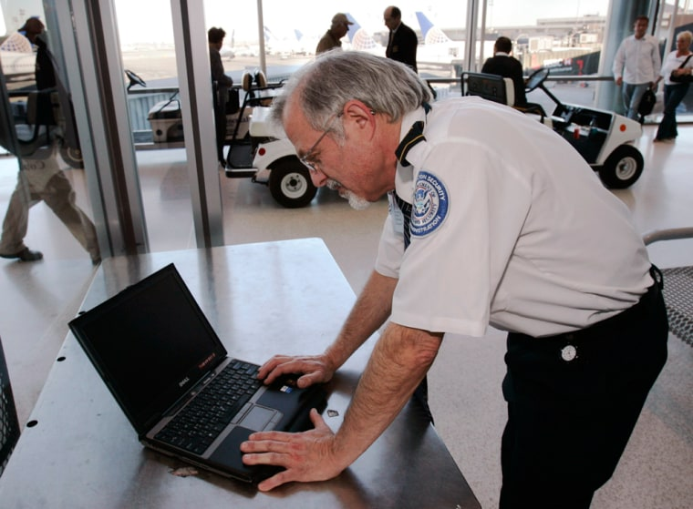 Image: Airport security with laptop
