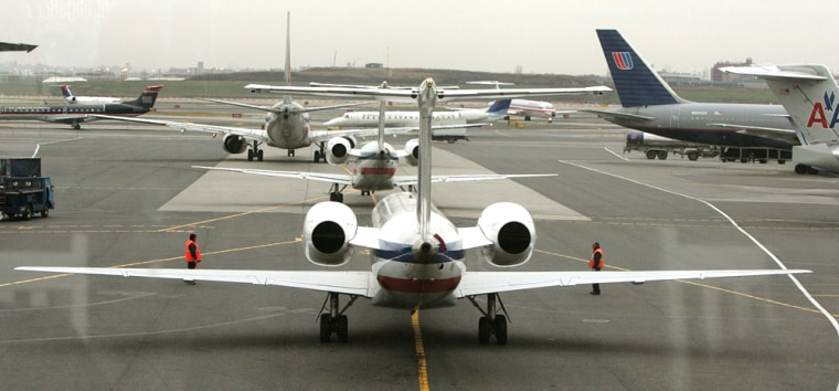 Image: Airplanes line up for take-off on one of LaGuardia Airport's two runways