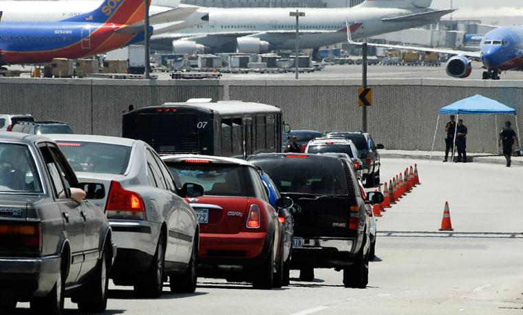 Image: Traffic backs up at a vehicle checkpoint at Los Angeles International Airport