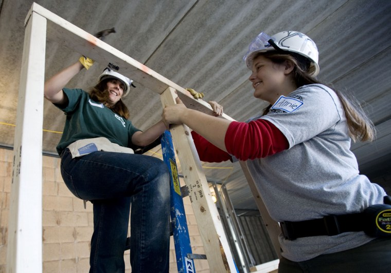 Image: Kerry Salter, left, and Annie Ledbury volunteer their time with Habitat for Humanity