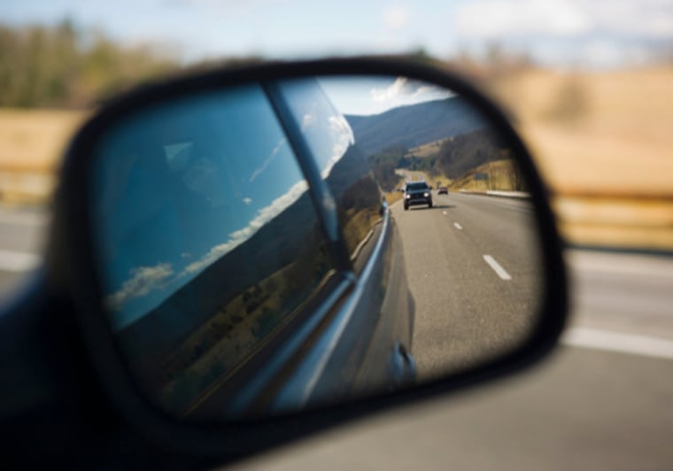Image: Car reflecting in side view mirror