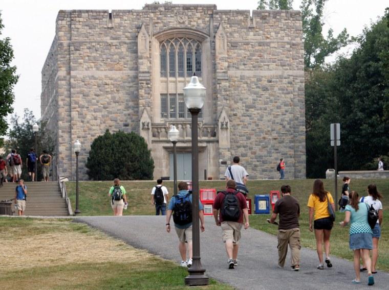 Image: Virginia Tech students walk to classes in front of Norris Hall at the school in Blacksburg, Va.