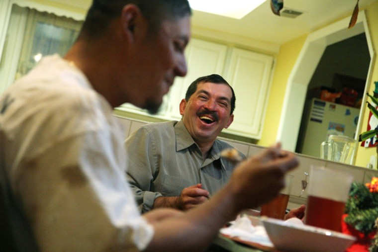 Francisco Ramirez, who originally entered the United States illegally years ago but who now has a green card, dines with Jose Angel Fuentes at Ramirez's home in Herndon, Va.