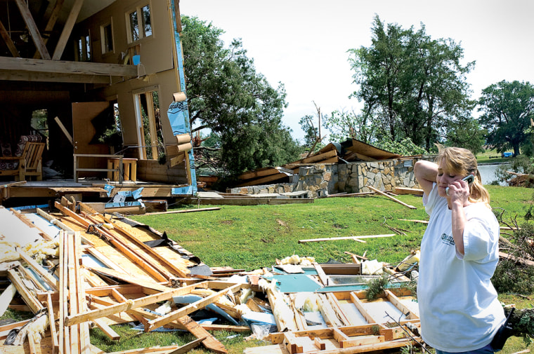 Melissa Tucker talks on her cellphone after a tornado ripped througha resort outside of Town Creek, Ala., on Thursday.