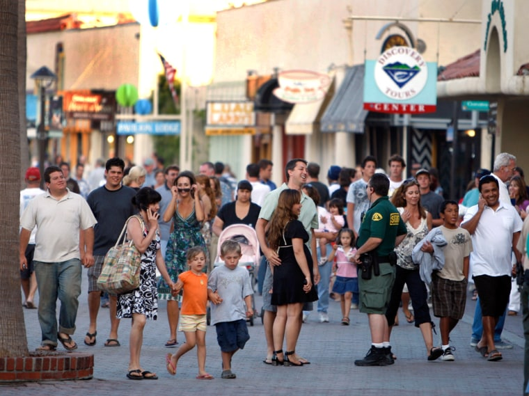 Los Angeles County Sheriff's Deputy David Mertens walks his beat in Avalon, Calif., on Catalina Island, on July 3. Hefears that gangs are getting a foothold on theexclusive island.