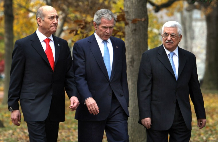 Image: US President George W. Bush (C) walks with Israeli Prime Minister Ehud Olmert (L) and Palestinian president Mahmud Abbas